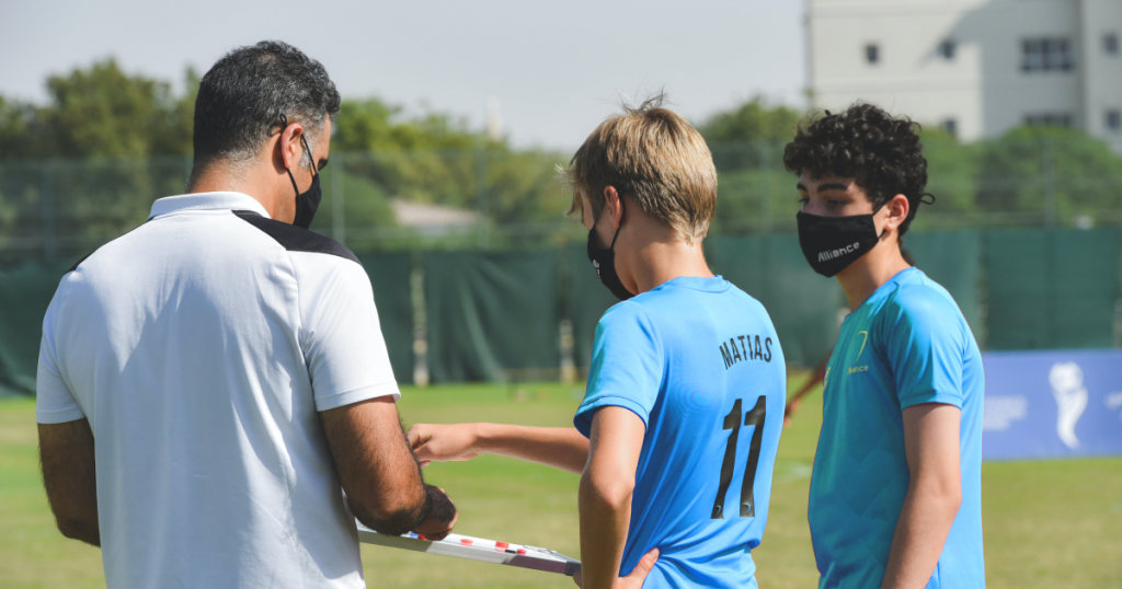 soccer coach with players
